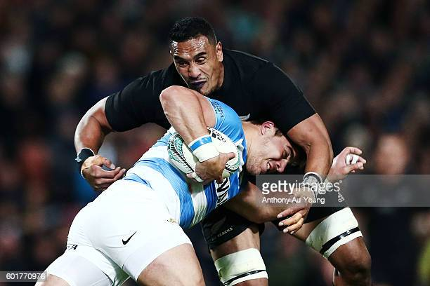 Facundo Isa of Argentina is tackled by Jerome Kaino of New Zealand during the Rugby Championship match between the New Zealand All Blacks and...