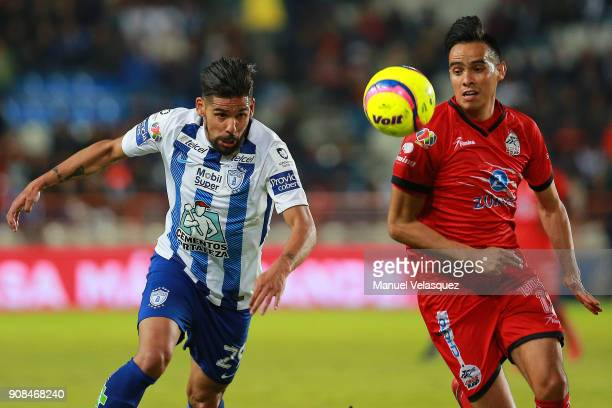 Facundo Jara of Pachuca struggles for the ball against Heriberto Olvera of Lobos BUAP during the 3rd round match between Pachuca and Lobos BUAP as...