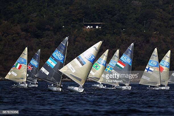 Facundo Olezza Bazan of Argentina Deniss Karpak of Estonia and Zsombor Berecz of Hungary compete in the Finn class races on Day 4 of the Rio 2016...