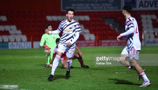 Facundo Pellistri of Manchester United U21's celebrates as he scores their first goal during the EFL Trophy match between Accrington Stanley and...