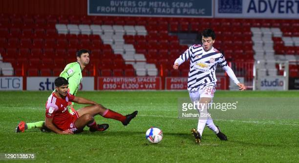 Facundo Pellistri of Manchester United U21's scores their first goal during the EFL Trophy match between Accrington Stanley and Manchester United...