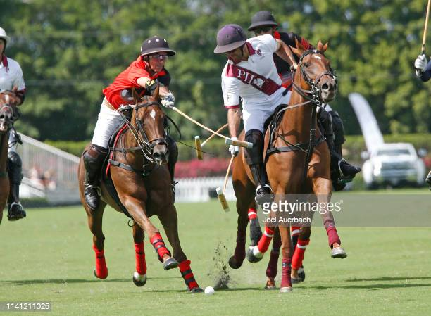 Facundo Pieres of Pilot and Mariano Agurerre of Postage Stamp battle for control of the ball during the 2019 Captive One US Open Polo Championship on...