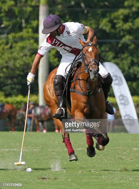 Facundo Pieres of Pilot brings the ball up field against Postage Stamp during the 2019 Captive One US Open Polo Championship on April 7 2019 at the...