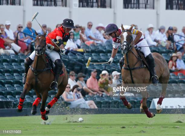 Facundo Pieres of Pilot plays the ball in front of Mariano Agurerre of Postage Stamp as they ride past the grandstand during the 2019 Captive One US...