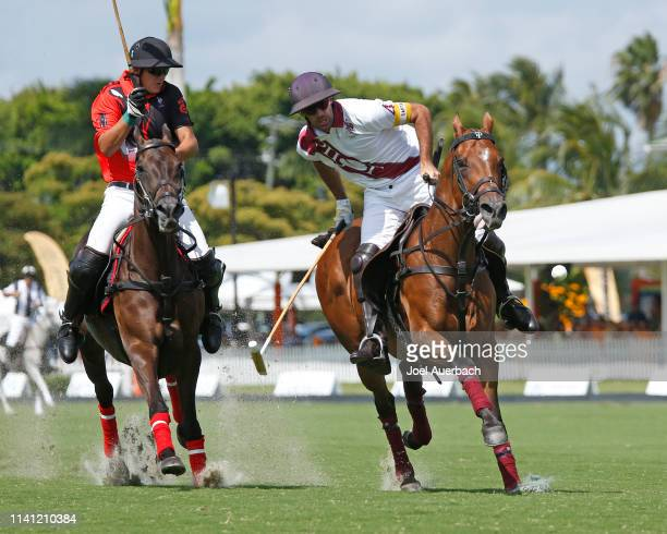 Facundo Pieres of Pilot plays the ball on goal against Joaquin Panelo of Postage Stamp during the 2019 Captive One US Open Polo Championship on April...