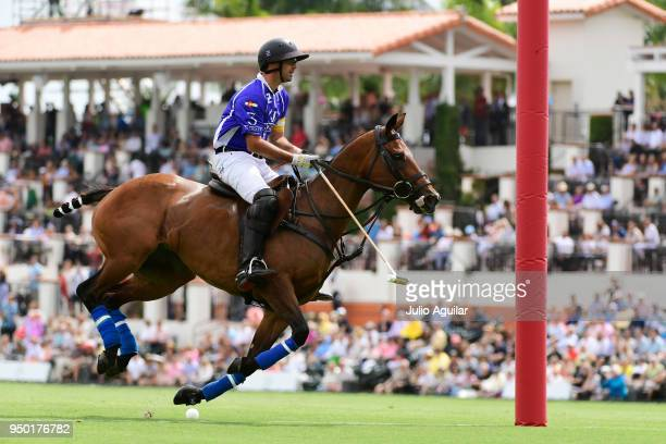 Facundo Pieres of Valiente walks in the first goal of the match in the US Open Polo Championship against The Daily Racing Form April 22 2018 in...