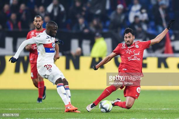 Facundo Piriz of Montpellier and Tanguy Ndombele of Lyon during the Ligue 1 match between Olympique Lyonnais and Montpellier Herault SC at Parc...