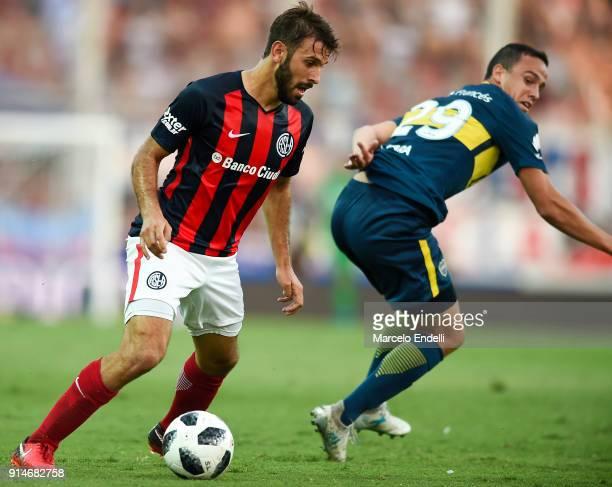 Facundo Quignon of San Lorenzo fights for ball with Leonardo Jara of Boca Juniors during a match between San Lorenzo and Boca Juniors as part of the...