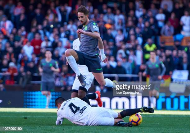 Facundo Roncaglia defender of Valencia CF competes for the ball with Adnan Januzaj midfielder of Real Sociedad during the La Liga match between...