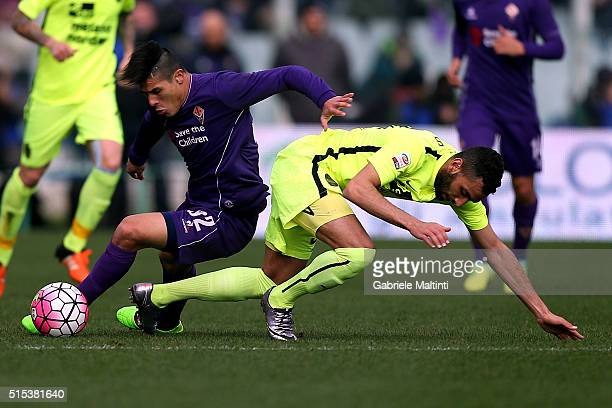 Facundo Roncaglia of ACF Fiorentina battles for the ball with Eros Pisano of Hellas Verona FC during the Serie A match between ACF Fiorentina and...