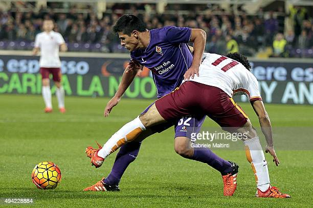 Facundo Roncaglia of ACF Fiorentina battles for the ball with Mohamed Salah of AS Roma during the Serie A match between ACF Fiorentina and AS Roma at...