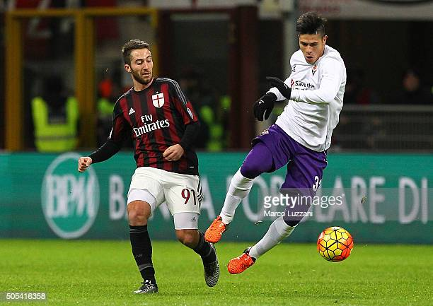 Facundo Roncaglia of ACF Fiorentina is challenged by Andrea Bertolacci of AC Milan during the Serie A match between AC Milan and ACF Fiorentina at...
