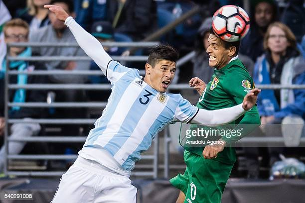 Facundo Roncaglia of Argentina struggles for the ball against Jhasmany Campos of Bolivia during the 2016 Copa America Centenario Group D match...