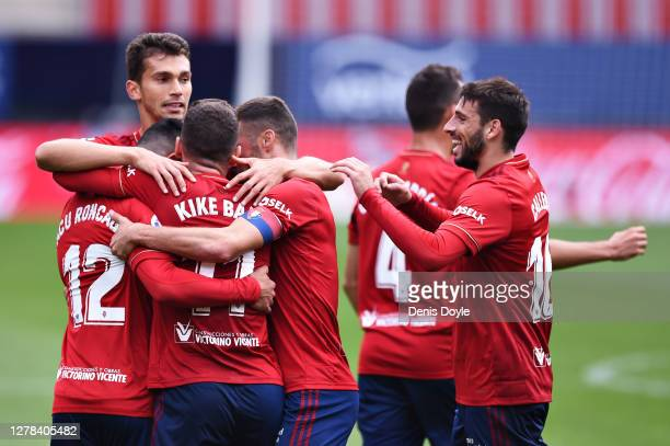 Facundo Roncaglia of CA Osasuna celebrates with teammates after scoring his sides first goal during the La Liga Santander match between C.A. Osasuna...