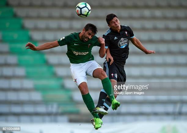 Facundo Roncaglia of Celta de Vigo competes for the ball with Joselu of Racing de Ferrol during the preseason friendly match between Celta de Vigo...
