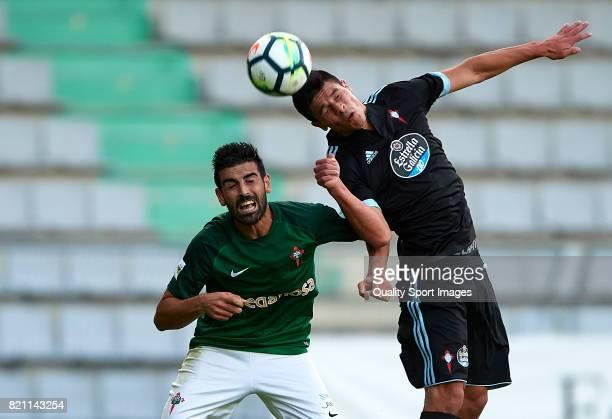 Facundo Roncaglia of Celta de Vigo competes for the ball with Maceira of Racing de Ferrol during the preseason friendly match between Celta de Vigo...