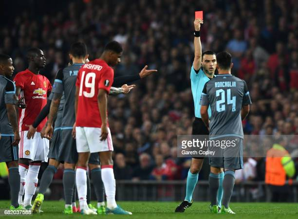 Facundo Roncaglia of Celta Vigo is shown a red card during the UEFA Europa League semi final second leg match between Manchester United and Celta...
