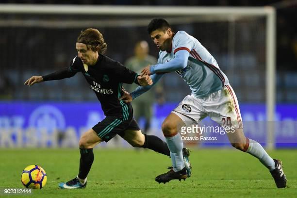Facundo Roncaglia of RC Celta de Vigo competes for the ball with Luka Modric of Real Madrid during the La Liga match between RC Celta de Vigo and...