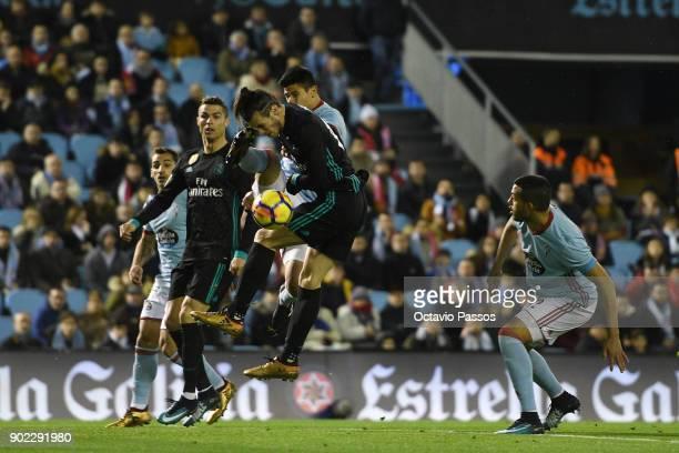 Facundo Roncaglia of RC Celta de Vigo competes for the ball with Gareth Bale of Real Madrid during the La Liga match between RC Celta de Vigo and...