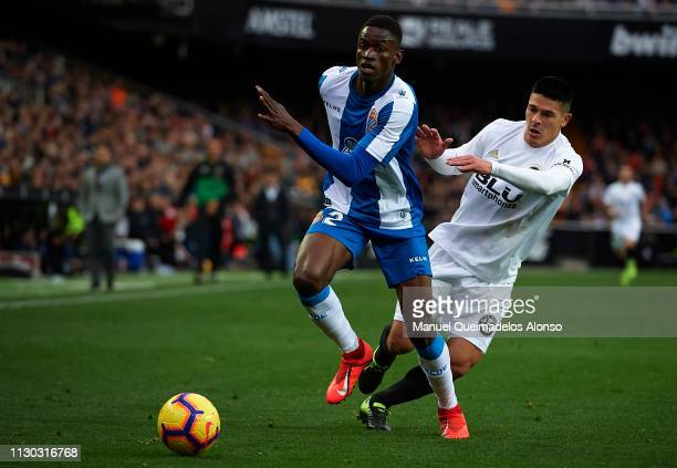 Facundo Roncaglia of Valencia competes for the ball with Alfa Semedo of Espanyol during the La Liga match between Valencia CF and RCD Espanyol at...