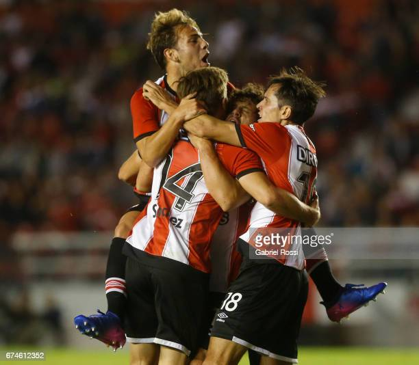 Facundo Sanchez of Estudiantes celebrates with teammates after scoring the first goal of his team during a match between Independiente and...