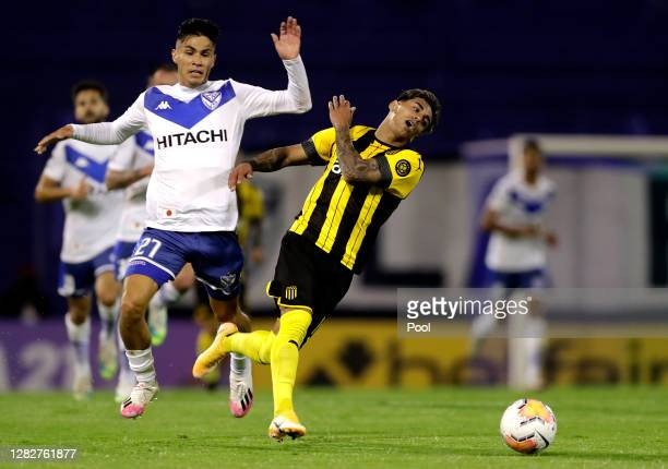 Facundo Torres of Peñarol fights for the ball with Pablo Galdames of Velez during a second round match of Copa CONMEBOL Sudamericana 2020 between...