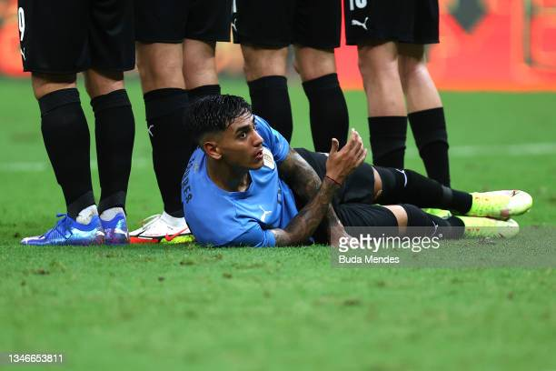 Facundo Torres of Uruguay lies on the pitch for a free kick of Brazil during a match between Brazil and Uruguay as part of South American Qualifiers...