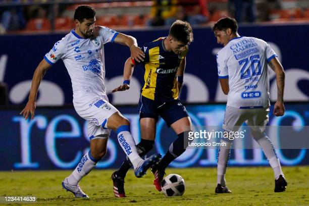 Facundo Waller of Atletico San Luis competes for the ball with Luis Madrigal and Maximiliano Perg of Queretaro during a second round match in the...