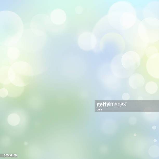 Faded glowing pale background with spots