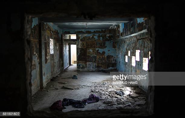 Faded movie posters some of them written in Hebrew hang on May 14 2016 on the charred walls of the abandoned alJalaa cinema house that was torched 20...