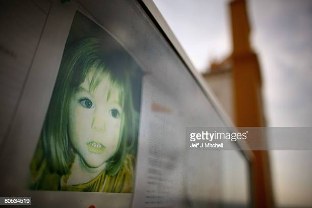 A faded photograph of Madeleine McCann is displayed on a church notice board where the toddler disappeared from the family holiday apartment last May...