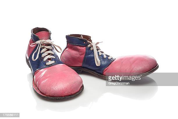 Faded red and blue clown shoes