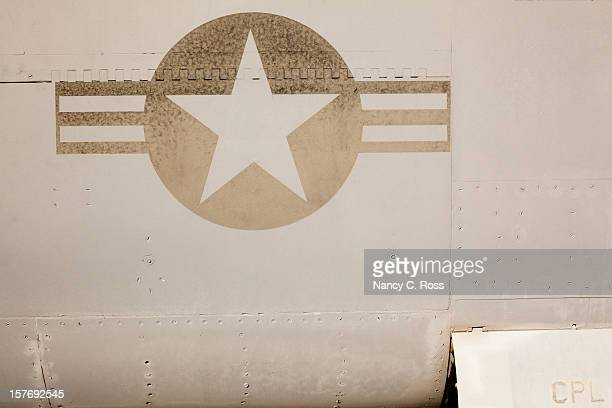 faded us air force insignia on side of jet aircraft - us military emblems stock pictures, royalty-free photos & images