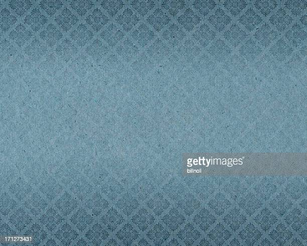 faded wallpaper with floral pattern