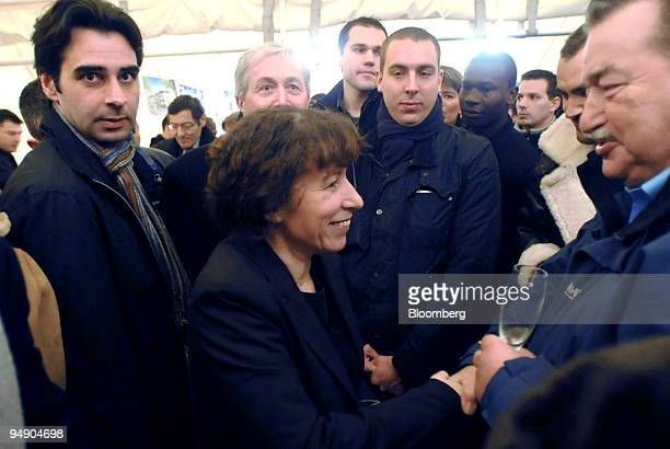 Fadela Amara French secretary of state for urban affairs and whose parents are Algerian greets residents during an official visit to the suburb of...