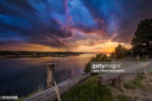 fading supercell over lake at sunset, ogallala, nebraska, us - nebraska stock pictures, royalty-free photos & images