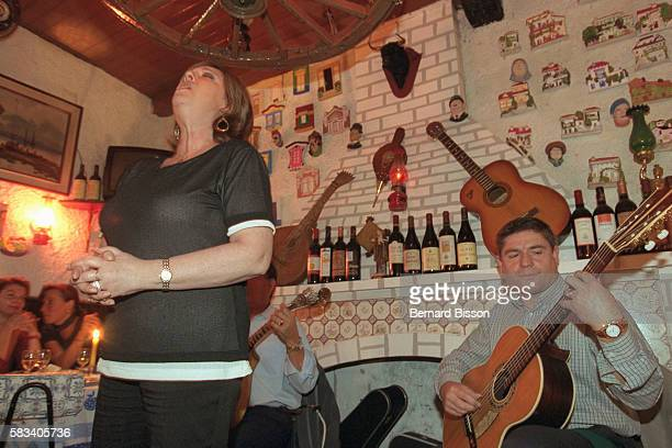 A Fado singer and guitarplayer at the club 'Cabacinha'