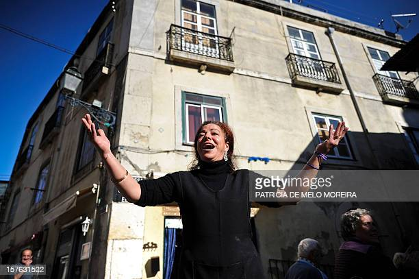 A Fado singer sings in the streets of Alfama neighbourhood in Lisbon on November 27 2011 Celebrations rang out in Portugal after Fado a type of...