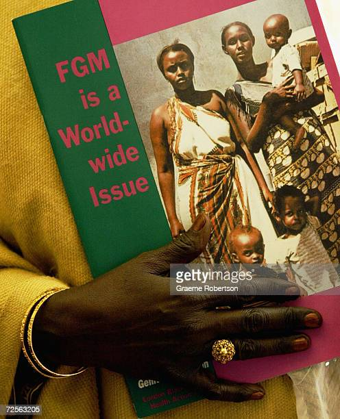 Faduma Ismail a survivor from Genital Mutilation is seen holding a book on March 3 2004 in London The Female Genital Mutilation Act which came into...