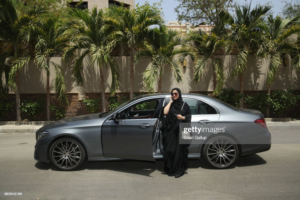 Fadya Fahad, 23, one of the first female drivers for Careem, a peer-to-peer ride sharing company similar to Uber, speaks on a mobile phone next to a car she has rented to drive on the first day she is legally allowed to drive in Saudi Arabia on June 24, 2018 in Jeddah, Saudi Arabia. Fadya lived in the United States, where she got her first license. ÒIt's so amazing,Ó she said of today. When asked what her parents thought about it, she sad: ÒThey are so proud. My father said I drive better than my brother.Ó Saudi Arabia has today lifted its ban on women driving, which had been in place since 1957. The Saudi government, under Crown Prince Mohammad Bin Salman, is phasing in an ongoing series of reforms to both diversify the Saudi economy and to liberalize its society. The reforms also seek to empower women by restoring them basic legal rights, allowing them increasing independence and encouraging their participation in the workforce. Saudi Arabia is among the most conservative countries in the world and women have traditionally had much fewer rights than men.