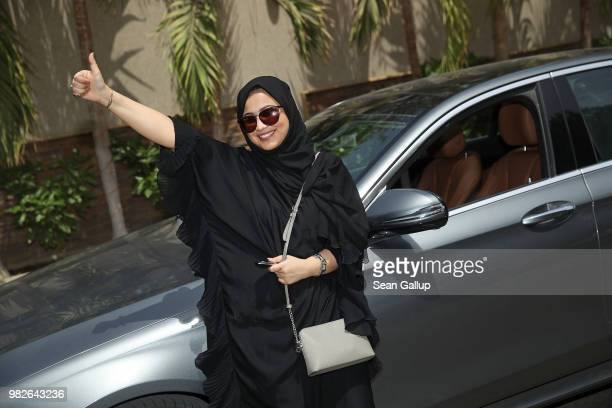 Fadya Fahad one of the first female drivers for Careem a peertopeer ride sharing company similar to Uber poses for a photo next to a car she has...