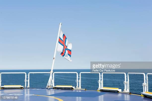 faeroe national flag at a ferry, near torshavn, faeroe islands - torshavn stock pictures, royalty-free photos & images