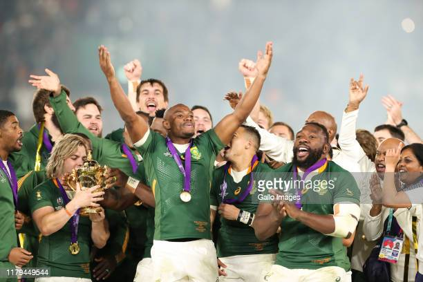 Faf de Klerk Mazakole Mapimpi and Tendai Mtawarira celebrates after the Rugby World Cup 2019 Final match between England and South Africa at...