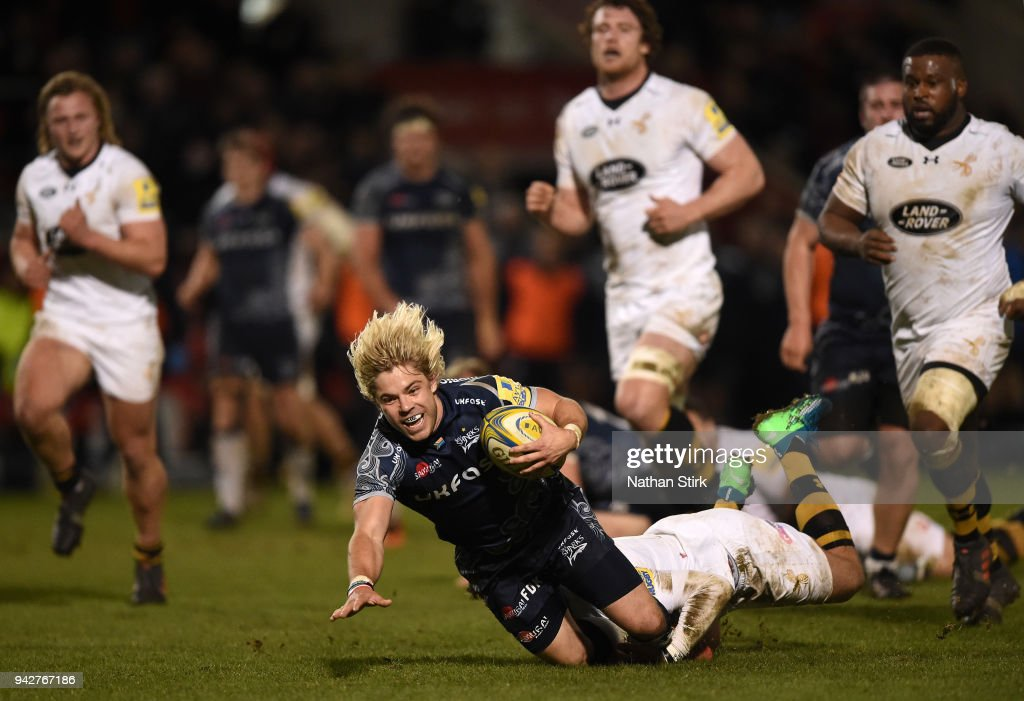 Faf de Klerk of Sale is tackled by the Wasps defence during the Aviva Premiership match between Sale Sharks and Wasps at AJ Bell Stadium on April 6, 2018 in Salford, England.