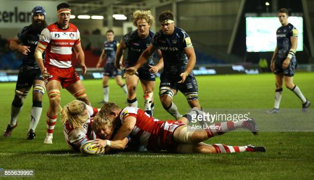 Faf de Klerk of Sale Sharks dives over the line to score a try during the Aviva Premiership match between Sale Sharks and Gloucester Rugby at AJ Bell...