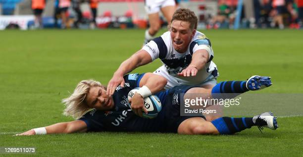 Faf de Klerk of Sale Sharks dives over to score their third try despite the attention from Tiff Eden during the Gallagher Premiership Rugby match...