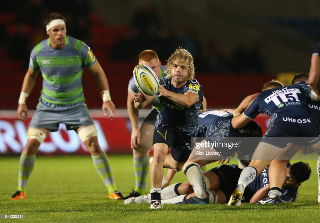 Faf de Klerk of Sale Sharks passes the ball during the Aviva Premiership match between Sale Sharks and Newcastle Falcons at AJ Bell Stadium on September 8, 2017 in Salford, England.