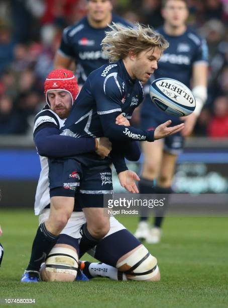 Faf De Klerk of Sale Sharks tackled by Aly Muldowney of Bristol Bears during the Gallagher Premiership Rugby match between Sale Sharks and Bristol...