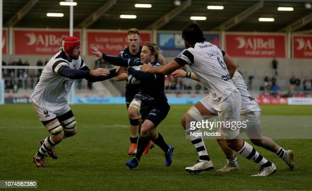 Faf De Klerk of Sale Sharks tackled by Steve Luatua and Aly Muldowney of Bristol Bears during the Gallagher Premiership Rugby match between Sale...