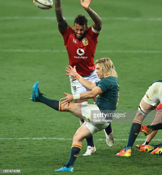 Faf de Klerk of South Africa kicks the ball past Courtney Lawes during the 2nd test match between South Africa Springboks and the British & Irish...